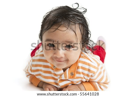 Portrait of a Smiling Newborn Baby Girl On Her Tummy, on white background - stock photo