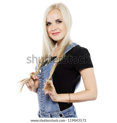 Portrait of a smiling next door girl in country style clothes over white background. Studio shot - stock photo