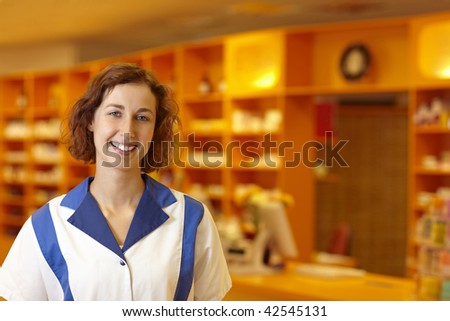 Portrait of a smiling pharmacist in pharmacy