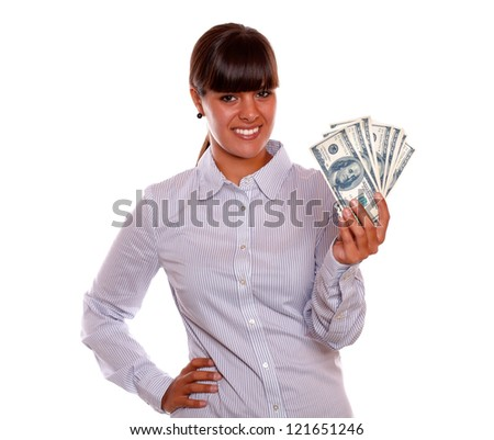 Portrait of a smiling pretty young woman holding dollars against white background - stock photo