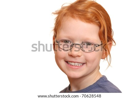 Portrait of a smiling red haired girl with glasses