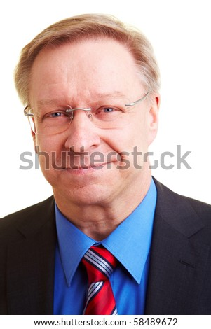 Portrait of a smiling senior businessman in a suit and tie