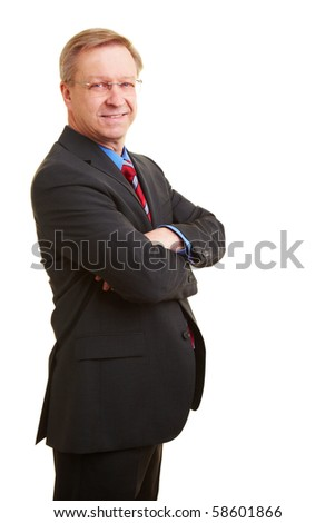 Portrait of a smiling senior businessman in a suit and tie - stock photo