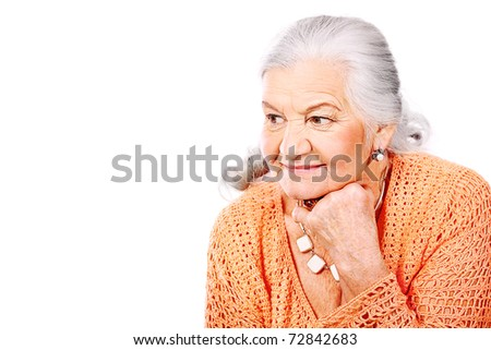 Portrait of a smiling senior woman. Isolated over white background. - stock photo