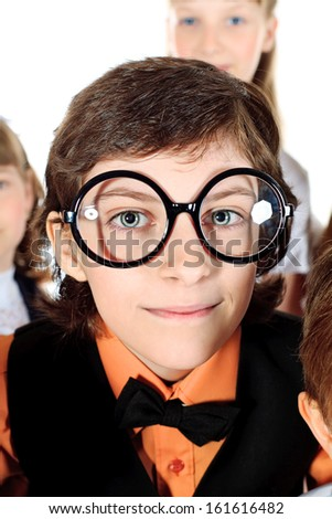 Portrait of a smiling student boy in big round glasses. Isolated over white. - stock photo