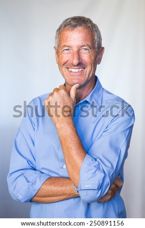 Portrait of a smiling successful mature handsome man - stock photo