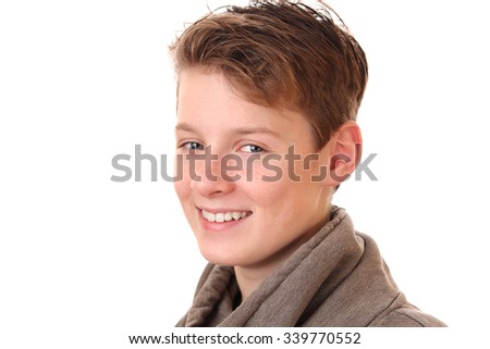 Portrait of a smiling teenage boy on white background - stock photo