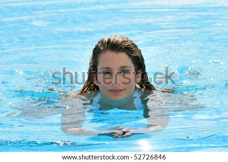 Portrait of a smiling woman in a swimming pool