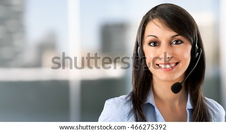 Portrait of a smiling woman using an headset