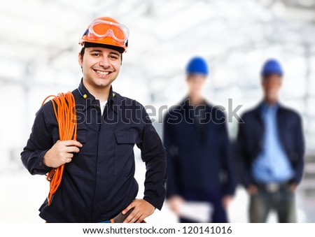 Portrait of a smiling worker - stock photo