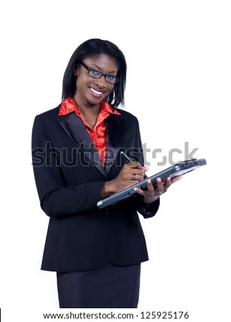 Portrait of a smiling young African American businesswoman writing on clipboard over white background - stock photo