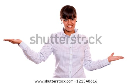 Portrait of a smiling young business female holding out her palms and showing you copyspace on white background - stock photo