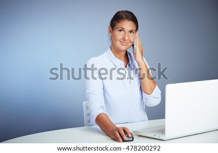 Portrait Of A Smiling Young Businesswoman With Her Smartphone