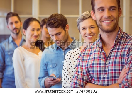 Portrait of a smiling young businesswoman with her team - stock photo