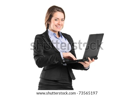 Portrait of a smiling young businesswoman working on a laptop isolated on white - stock photo