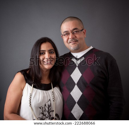 Portrait of a smiling, young East Indian couple