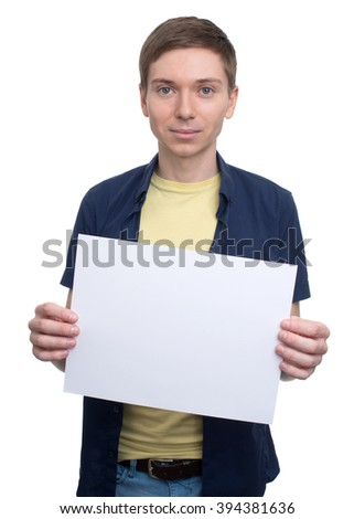 portrait of a smiling young handsome man with blank banner - stock photo