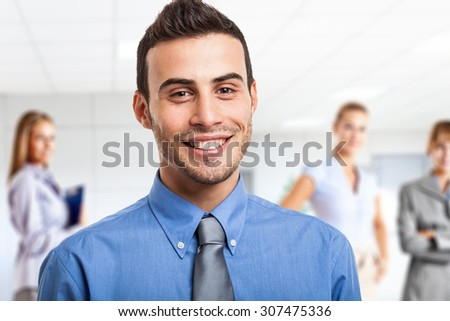 Portrait of a smiling young leader - stock photo