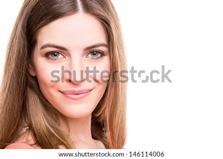 Portrait of a smiling young woman - stock photo