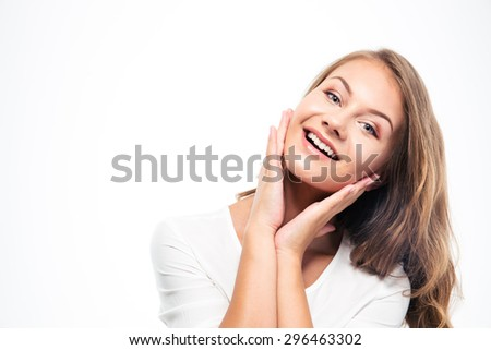 Portrait of a smiling young woman isolated on a white background - stock photo