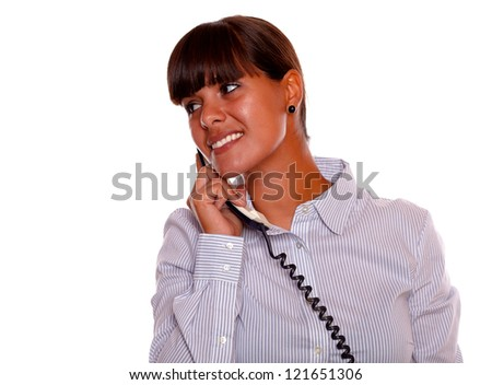 Portrait of a smiling young woman looking right with phone on isolated background - copyspace - stock photo