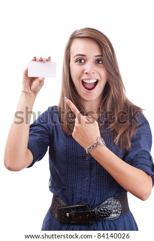 Portrait of a smiling young woman pointing at blank card in her hand against white background - stock photo