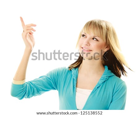 Portrait of a smiling young woman pointing up - stock photo