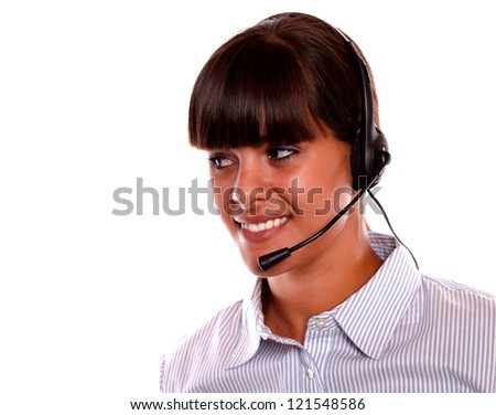 Portrait of a smiling young woman using earphone looking to her right on isolated background - copyspace - stock photo