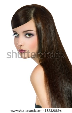 Portrait of a smiling young woman with beautiful long hair, isolated on a white background