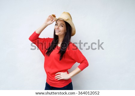 Portrait of a smiling young woman with cowboy hat - stock photo