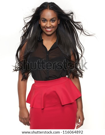 Portrait of a smiling young woman with flowing hair - stock photo