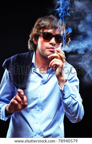 Portrait of a smoking man in sunglasses