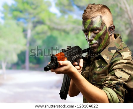 Portrait Of A Soldier Aiming With Gun, outdoor