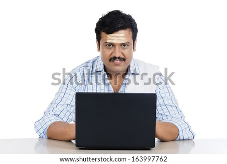 Portrait of a South Indian man using a laptop