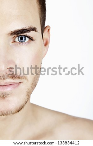 Portrait of a sportive young man isolated on white half face - stock photo