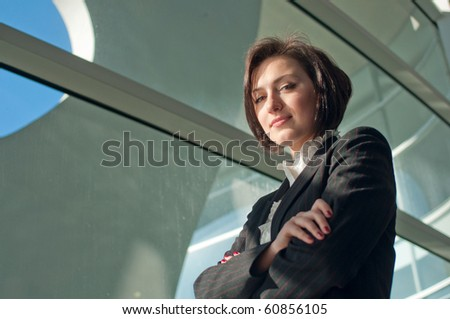 Portrait of a standing businesswoman with crossed arms - stock photo