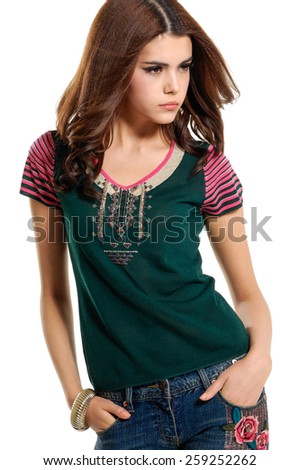 Portrait of a standing young woman in jeans posing - stock photo