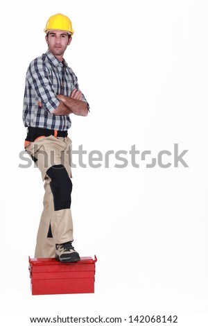 Portrait of a standoffish tradesman - stock photo
