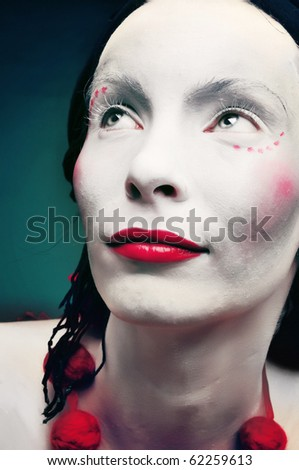 portrait of a strange woman mime or a clown  and bodypainting - stock photo