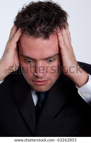Portrait of a stressed businessman - stock photo