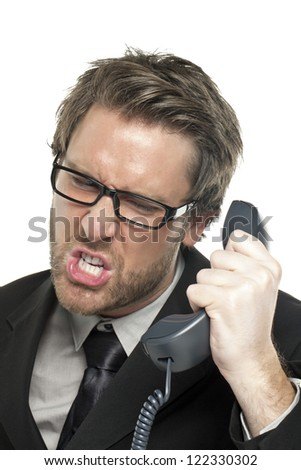 Portrait of a stressed businessman answering call over the white background