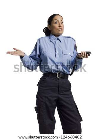 Portrait of a stressed female police officer against the white background - stock photo