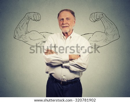 Portrait of a strong Old Man isolated on gray wall background  - stock photo