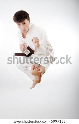 Portrait of a styled professional model. Theme: sport oriental martial art. - stock photo