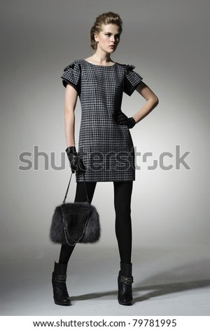 Portrait of a styled professional model with handbag posing - stock photo