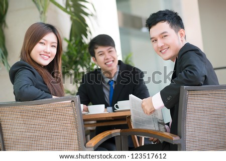 Portrait of a successful business team having a break together - stock photo