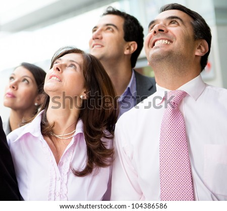 Portrait of a successful business team looking up - stock photo