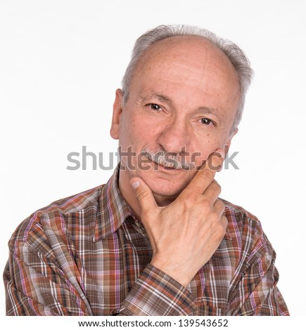 Portrait of a successful elderly man on white background