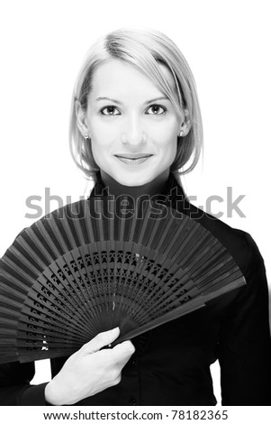 Portrait of a successful,  elegant, atractive, business woman wearing black blouse holding folding fan. - stock photo