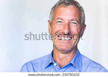 Portrait of a successful handsome mature man smiling  - stock photo
